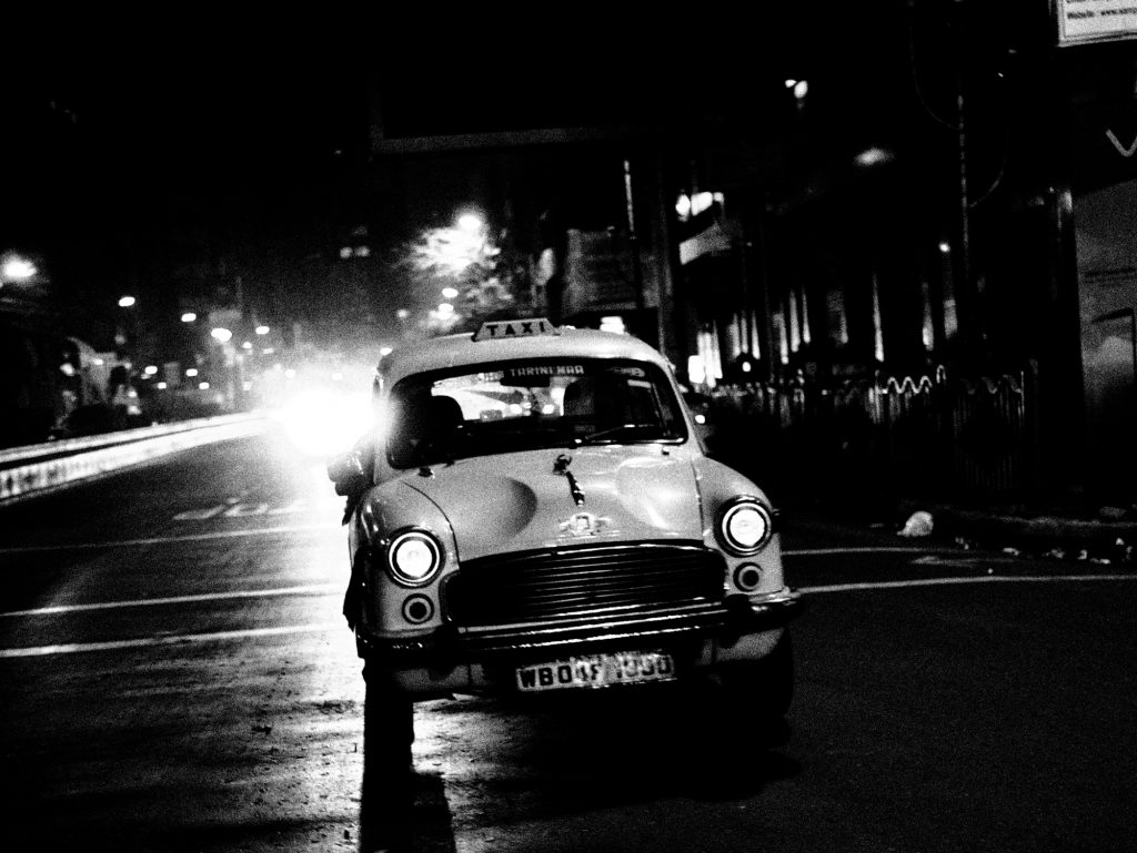 black and white street photography taxi kolkata